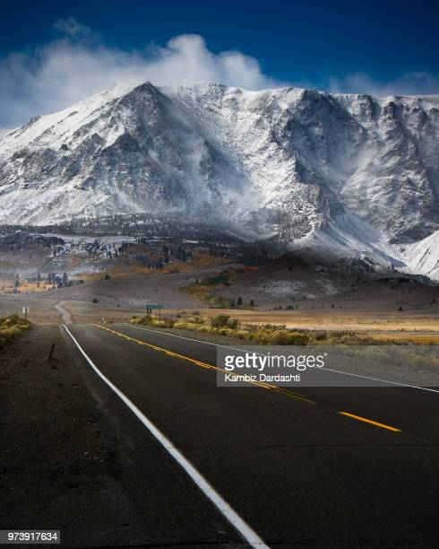 Empty road and mountains in background, June Lake Loop, Mammoth Lakes, California, USA