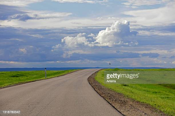 Empty road and rain clouds forming over the Gobi desert, rain shadow desert turning green in summer, Southern Mongolia.