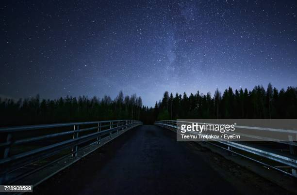 empty road at night - teemu tretjakov stock pictures, royalty-free photos & images