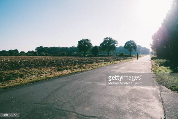 Empty Road By Agricultural Field