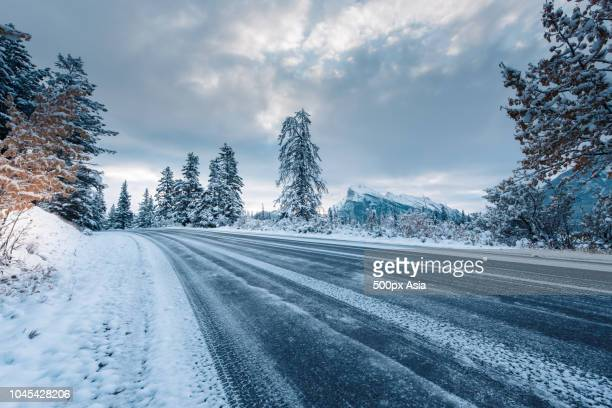 empty road during winter day, canada - image stock pictures, royalty-free photos & images