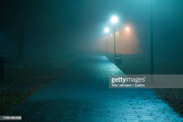 empty road in city at night - curfew stock pictures, royalty-free photos & images