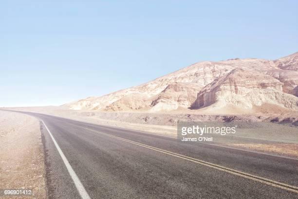 Empty road in desert landscape