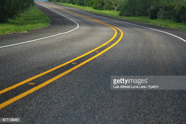empty road in forest - double yellow line stock photos and pictures