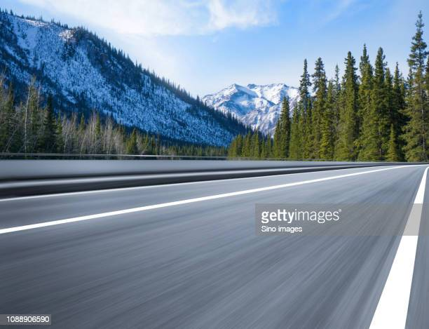 empty road in mountains, canada - image stock pictures, royalty-free photos & images
