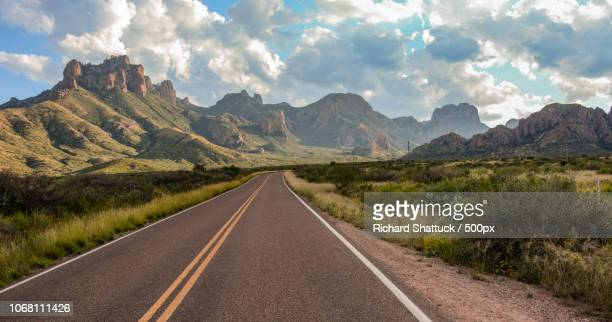 empty road in mountains - chisos mountains stock pictures, royalty-free photos & images