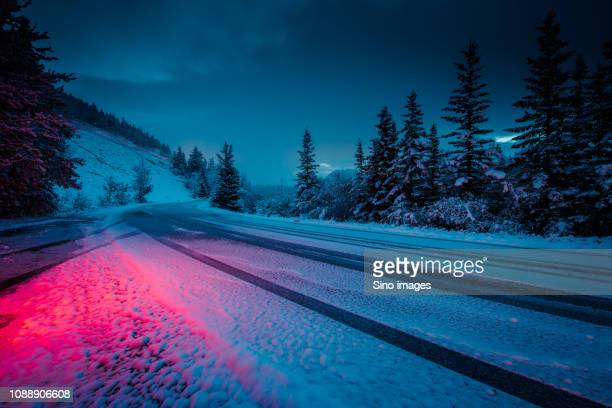 empty road in mountains seen from car, canada - image stock pictures, royalty-free photos & images