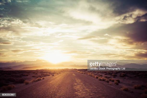 empty road in remote desert - dramatic sky stock pictures, royalty-free photos & images