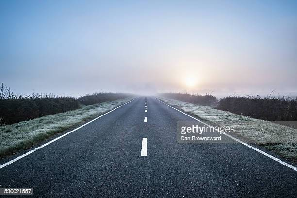 empty road in rural setting, northamptonshire, england - beginnings stock pictures, royalty-free photos & images