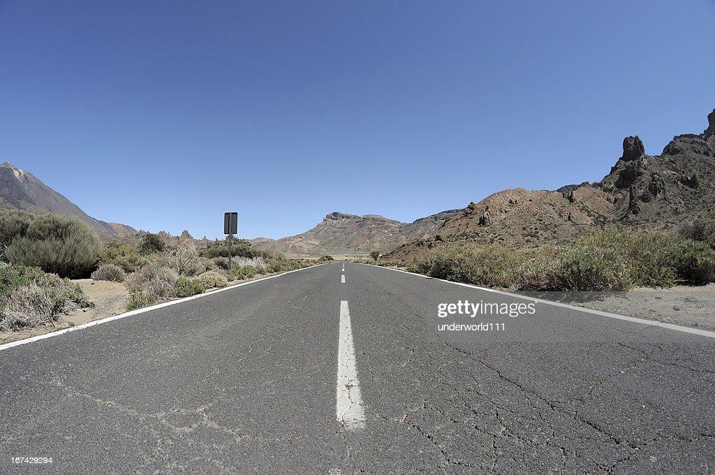 Empty road in the desert to infinity : Stock Photo