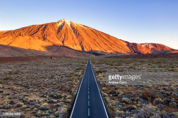 empty road in the teide national park. tenerife, canary islands, spain - el teide national park stock pictures, royalty-free photos & images