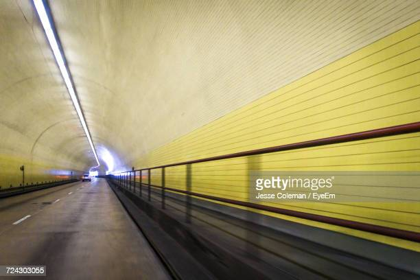 empty road in tunnel - jesse coleman stock pictures, royalty-free photos & images