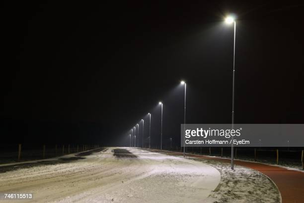 Empty Road In Winter At Night