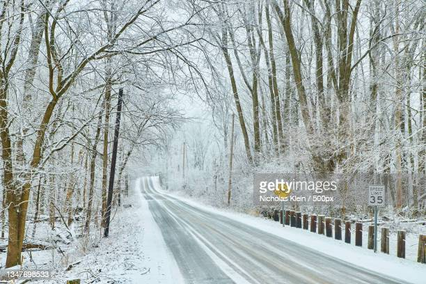 empty road in winter - klein stock pictures, royalty-free photos & images