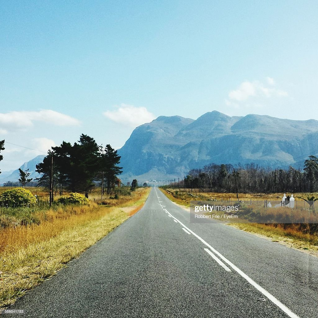 Empty Road Leading Towards Mountains : Stock Photo
