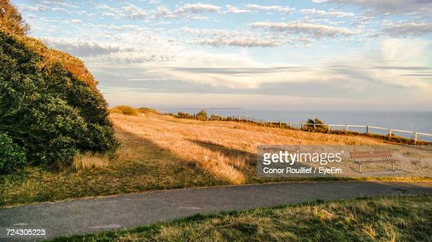 empty road leading towards sea - conor stock pictures, royalty-free photos & images