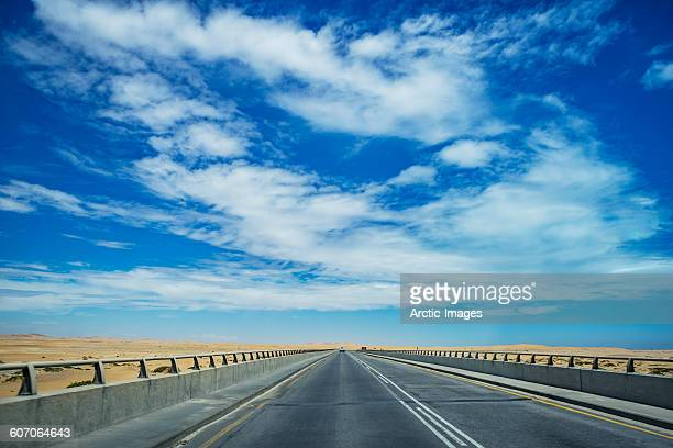 empty road, namibia - walvis bay stock photos and pictures