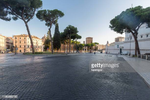 empty road of rome at morning - square stock pictures, royalty-free photos & images