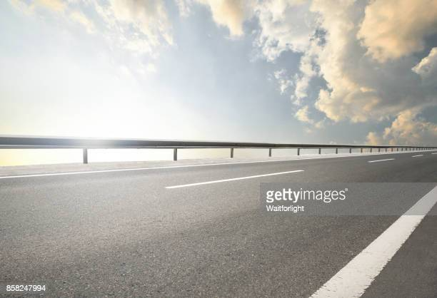 empty road on cloud - roadside stock pictures, royalty-free photos & images