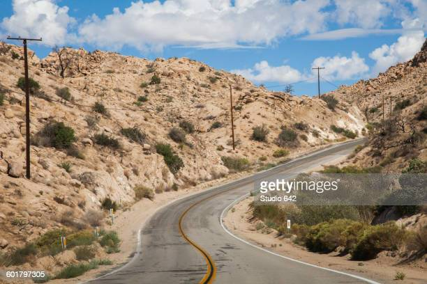 Empty road on rural desert hillside