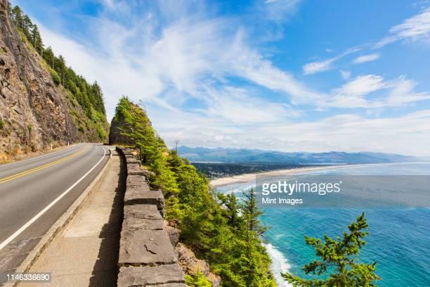 empty road over beach coastline - manzanita stock pictures, royalty-free photos & images