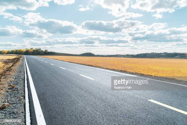 empty road - rolling hills sun stock pictures, royalty-free photos & images