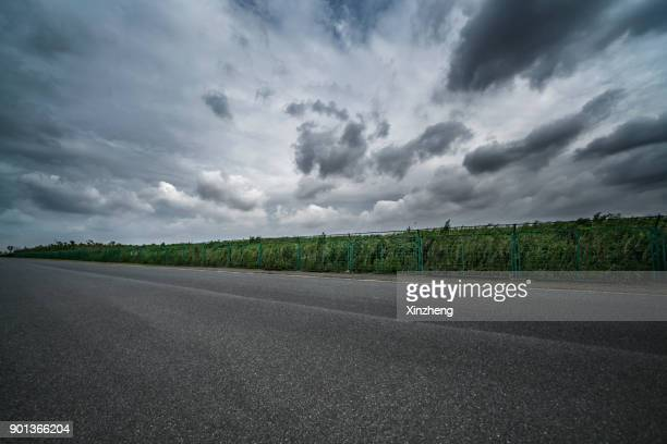 empty road - overcast stock pictures, royalty-free photos & images