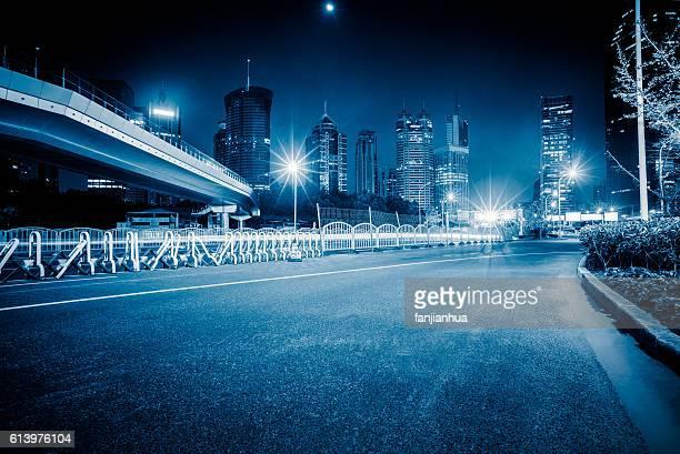 Empty road through modern city