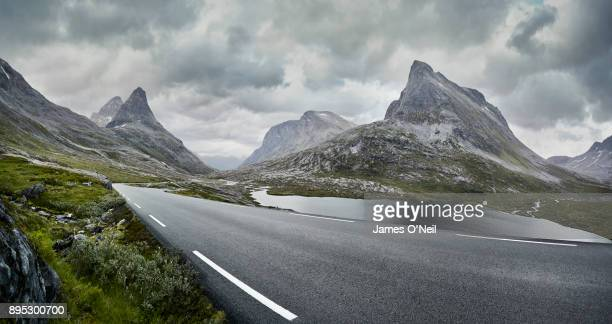 Empty road through stormy mountain landscape, Norway
