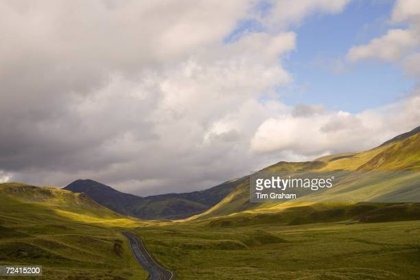 Empty road through the Glen Clunie hills and Grampian Mountains, Scotland.