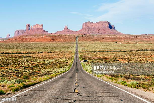Empty road to Monument Valley, Arizona, USA