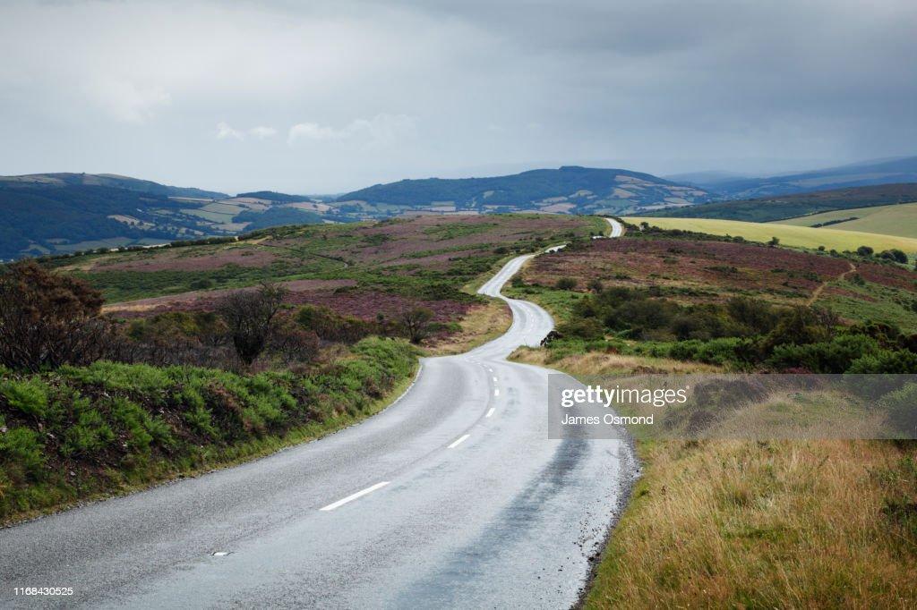 Empty road winding across moorland. : Stock Photo