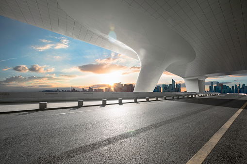 Empty road with city skyline - gettyimageskorea