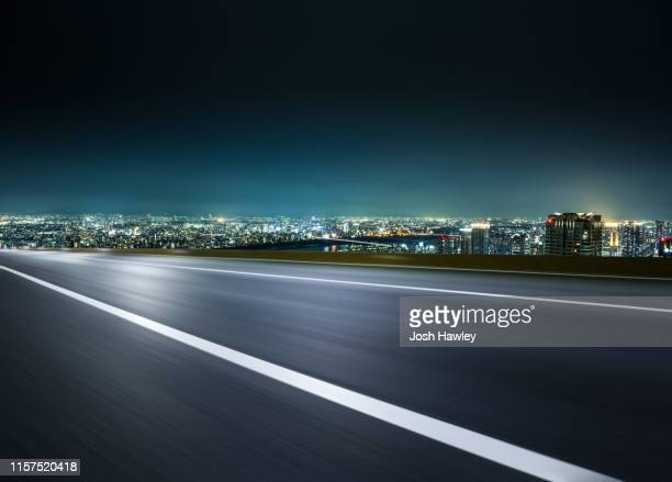 empty road with cityscape background - 都市生活 ストックフォトと画像