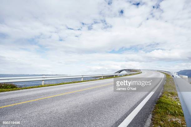 Empty road with distant bridge, Atlantic road, Norway