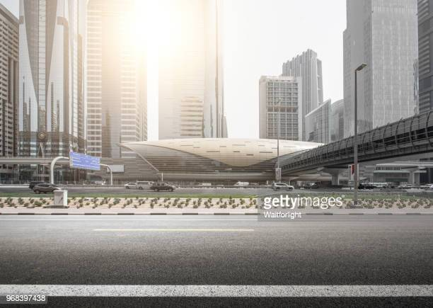 empty road with dubai downtown background - dubai stock pictures, royalty-free photos & images