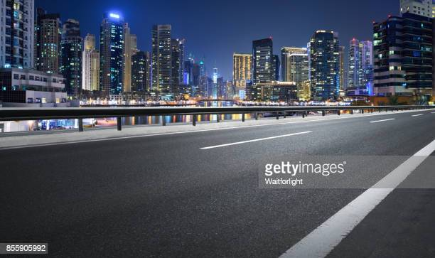 Empty road with Dubai marina background