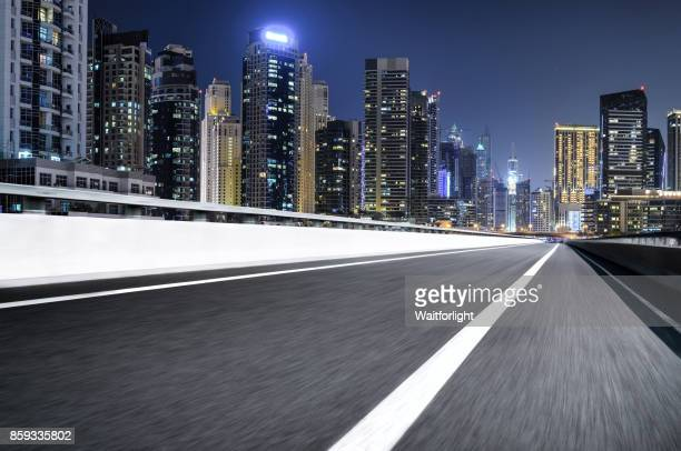 Empty road with Dubai marina