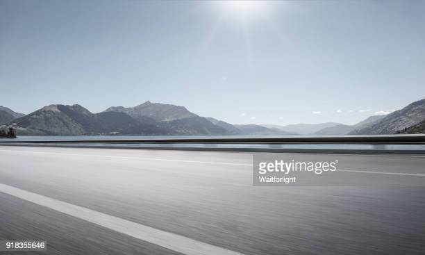 Empty road with lake background
