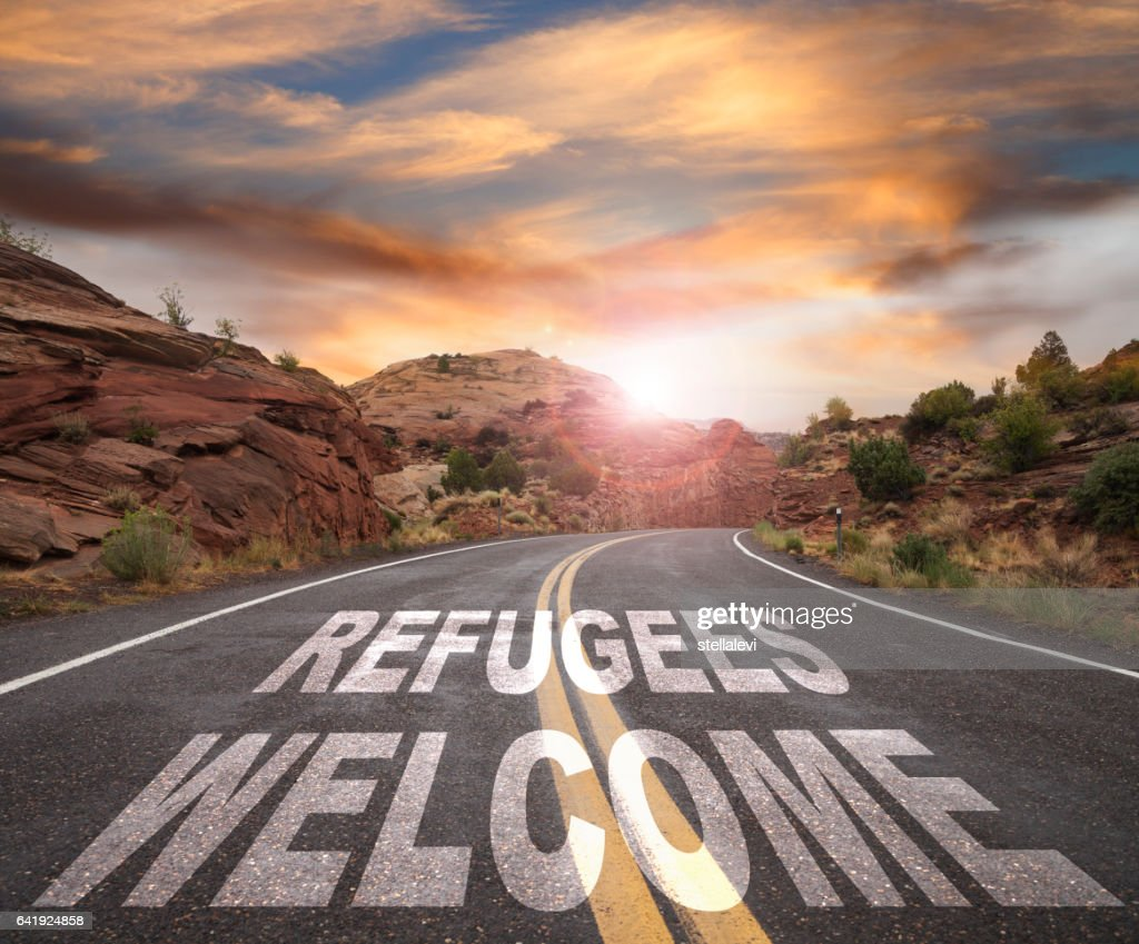 empty road with refugees welcome text at sunrise stock photo getty