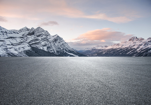 Empty road with snowcapped mountain background - gettyimageskorea