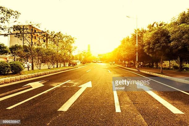 empty road with traffic sign in sunny sky