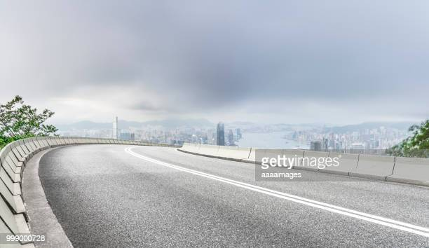 empty road with victoria harbor on background,hong kong - 高架道路 ストックフォトと画像