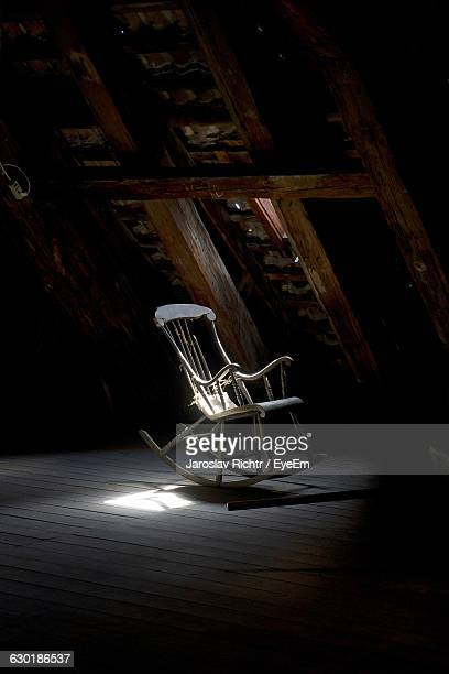 Empty Rocking Chair Against The Wall