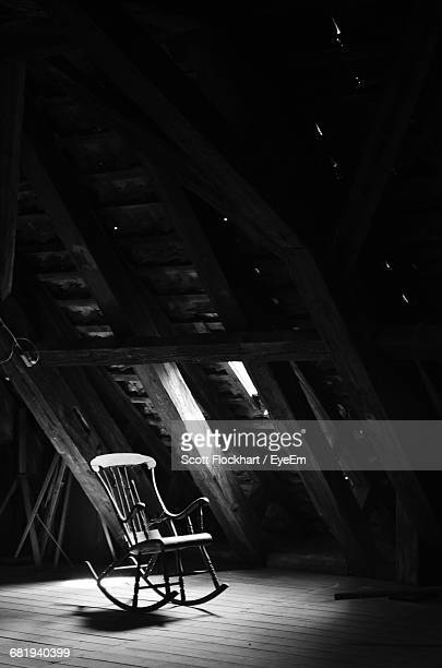 empty rocking chair against the wall - rocking chair stock photos and pictures