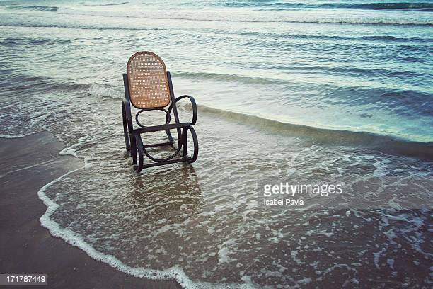 Empty rocking chair in the sea