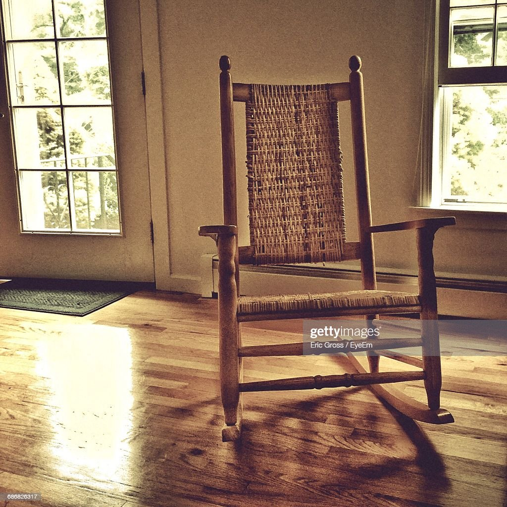 Empty Rocking Chair On Hardwood Floor At Home