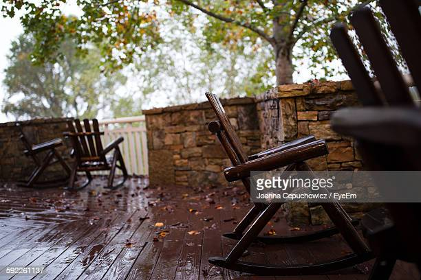 Empty Rocking Chairs In Patio During Rainy Season