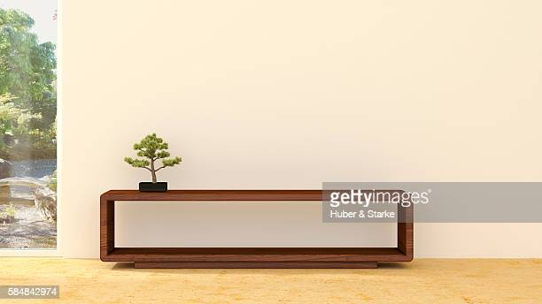 Empty room and Bonsai pine on sideboard
