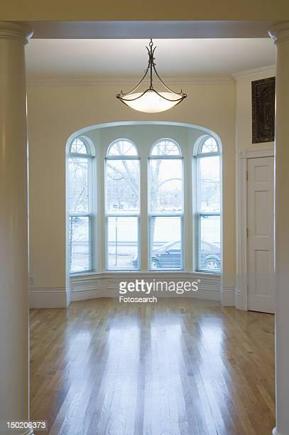 Empty room in apartment with hardwood floor and bay window